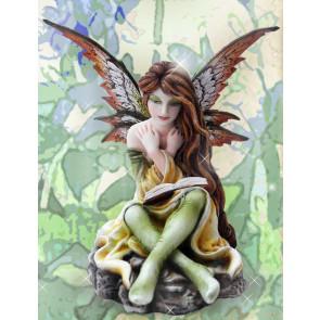 Fée avec un livre figurine féerique elfe (13x12cm)